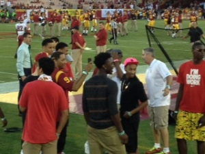 Basketball targets Stanley Johnson (center), Jordan McLaughlin (pink hat) and Jabari Craig (red shirt) enjoy the sidelines before USC's football game against Washington State. (Russell Simon/Galen Central)