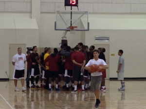The Trojans huddle up after their final practice before tomorrows scrimmage.