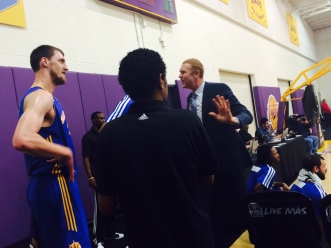Scalabrine gives Kuzmic some sideline advice. (Jacob Freedman/Galen Central)