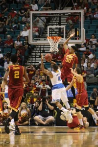 Malik Martin tries to block a shot by UCLA's Norman Powell (Photo by Josh Faskowitz).