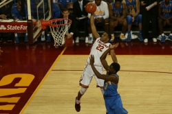 USC Trojans guard De'Anthony Melton (22) dunks the ball in front of UCLA Bruins guard Aaron Holiday (3) dunks the ball during the first half of an NCAA college basketball game  on Sunday, Jan. 25, 2017, in Los Angeles. (Michael Yanow)